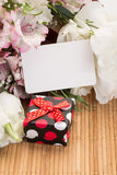Gift and flowers Royalty Free Stock Photo