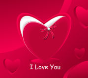 Gift in form red heart and with red bow pearl Royalty Free Stock Photography