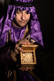 Gift of Frankincense. Magi with a  golden box filled with Frankincense.   Frankincense is the hardened resin of the Boswellia tree. This is frankincense from Stock Photos