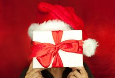 Gift in front of face Royalty Free Stock Images