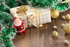 Gift, a garland of golden balls, Santa Claus Royalty Free Stock Images