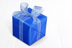 Gift. Box bow ribbon present red background Royalty Free Stock Photography