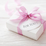 Gift with gift tag Stock Images