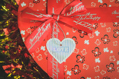 Gift. S, price ,sent, red ,heart ,ribbon ,tape ,box Royalty Free Stock Photography