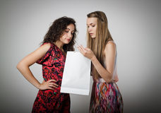 Gift. Girl is not satisfied with the present she got from someone royalty free stock photo