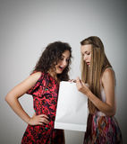 Gift. Girl is not satisfied with the present she got from someone royalty free stock image