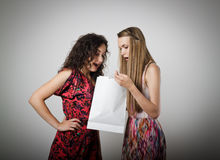 Gift. Girl is not satisfied with the present she got from someone royalty free stock photos