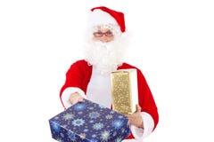 Gift given by Santa Claus Stock Photos
