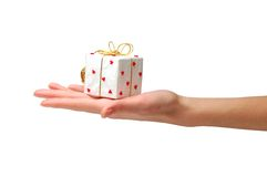 Gift giving. Hand with gift on a white background Royalty Free Stock Image