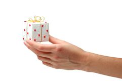 Gift giving. Hand with gift on a white background Stock Image