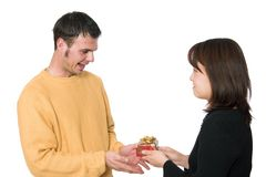 Gift giving 2. A cute asian girl gives he boyfriend a christmas present Stock Images
