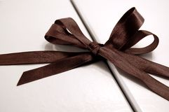 The gift of giving. Silver gift box with black bow Stock Photography