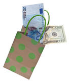 Gift Giving Budget. Money and a Gift Bag Symbolize a Gift Giving Budget Concept.  Isolated on White with a Clipping Path Royalty Free Stock Photos