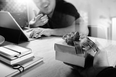 Gift Giving.business creative designer hand giving his colleague Stock Photo