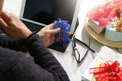 Gift giving Creative Hand chosing and hand with gift. Gift deliv Royalty Free Stock Photo