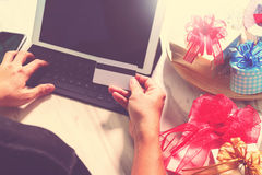 Gift giving Creative Hand with credit card and hand with gift. G Stock Image