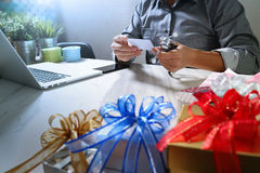 Gift giving,medical doctor Hand with credit card and hand with g Royalty Free Stock Photos