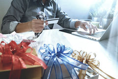 Gift giving,medical doctor Hand with credit card and hand with g Royalty Free Stock Images