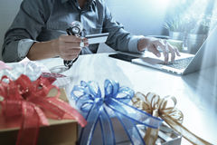 Gift giving,medical doctor Hand with credit card and hand with g Stock Image