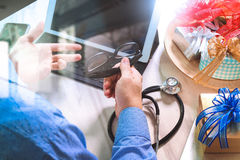 Gift giving,medical doctor Hand with credit card and hand with g Stock Photo