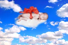 Gift from God Fantasy Portrait Infant With Bow in the Clouds Royalty Free Stock Photography