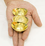 Gift of gold. A handful of gold ingots Stock Image