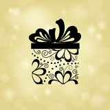Gift on gold background Royalty Free Stock Image