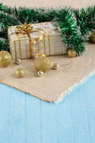 Gift, gold balls on the background cloth Royalty Free Stock Photography