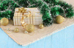 Gift, gold balls on the background cloth Stock Image