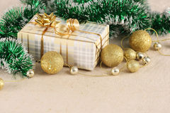 Gift, gold balls on the background cloth Stock Photos