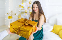 Gift in gold box for the beautiful woman for Christmas stock photo