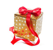 Gift in gold box with a red bow. Stock Images
