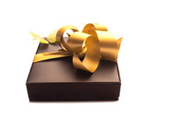 Gift with gold ribbon. Gift gold ribbon with a white background Stock Photography