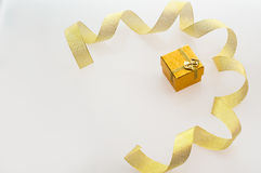 Gift with gold ribbon, place for your text Stock Image
