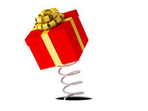 Gift with a gold ribbon on a spring Stock Image
