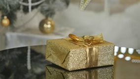 Gift in gold spining box under tree for Christmas stock video footage