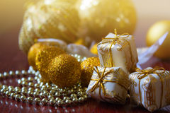 Gift in golden box on a background of Christmas balls.new Year d. New Year decoration. Christmas ornaments, christmas decoration Stock Images