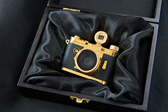 Gift golden camera in a wooden box Royalty Free Stock Photo