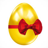Gift golden easter egg. Royalty Free Stock Images