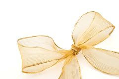 Gift golden ribbon and bow. Isolated on white background stock image