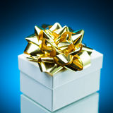Gift with golden ribbon bow Stock Images
