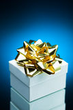 Gift with golden ribbon bow Royalty Free Stock Image