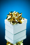 Gift with golden ribbon bow Stock Photo