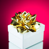 Gift with golden ribbon bow Stock Photos