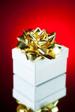 Gift with golden ribbon bow Royalty Free Stock Photo