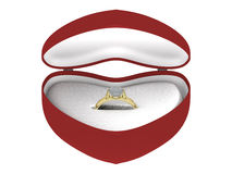 Gift golden ring in a box. A golden ring with a gem in a heart shaped box Stock Photo