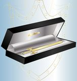 Gift golden sword. In a decorative black box miniature golden sword Royalty Free Stock Images