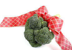 The Gift of Good Health. Bunch of fresh broccoli tied with festive red ribbon stock image