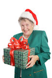 Gift For Grandmother. A sweet grandmother receiving a christmas gift. Isolated on white stock photography