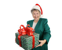 Gift From Grandmother. A pretty grandmother in a Santa hat giving you a gift. Isolated on white royalty free stock image